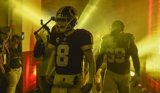 Washington Redskins quarterback Kirk Cousins (8) walk through the tunnel before an NFL football game against the New York Giants in Landover, Md., Sunday, Jan. 1, 2017. (AP Photo/Nick Wass)