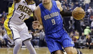 Orlando Magic center Nikola Vucevic (9) drives against Indiana Pacers forward Thaddeus Young (21) during the first half of an NBA basketball game in Indianapolis, Sunday, Jan. 1, 2017. (AP Photo/Michael Conroy)