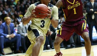 Purdue guard Carsen Edwards (3) drives past Minnesota guard DuPree McBreyer (1) during the second half of an NCAA college basketball game, Sunday, Jan. 1, 2017, in West Lafayette, Ind. Minnesota won 91-82. (AP Photo/R Brent Smith)