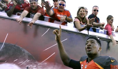 Tampa Bay Buccaneers quarterback Jameis Winston (3) celebrates with the fans as he leaves the field following the Buccaneers' 17-16 win over the Carolina Panthers during an NFL football game Sunday, Jan. 1, 2017, in Tampa, Fla. (AP Photo/Jason Behnken)