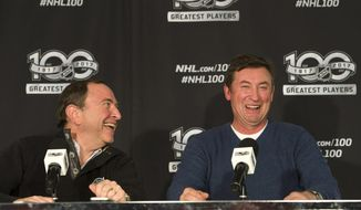 NHL Commissioner Gary Bettman, left, and Wayne Gretzky speak to the media before the Toronto Maple Leafs played the Detroit Red Wings during the NHL Centennial Classic in Toronto on Sunday, Jan. 1, 2017. (Nathan Denette/The Canadian Press via AP)