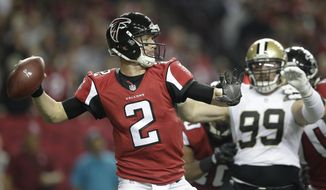 Atlanta Falcons quarterback Matt Ryan (2) passes the ball as New Orleans Saints defensive end Paul Kruger (99) looks on during the first half of an NFL football game, Sunday, Jan. 1, 2017, in Atlanta. (AP Photo/David Goldman)