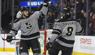 Los Angeles Kings defenseman Drew Doughty, right, is congratulated on his goal by center Nic Dowd during the second period of an NHL hockey game against the San Jose Sharks, Saturday, Dec. 31, 2016, in Los Angeles. (AP Photo/Mark J. Terrill)