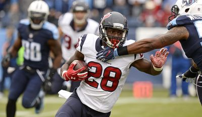 Houston Texans running back Alfred Blue (28) runs the ball against the Tennessee Titans in the first half of an NFL football game Sunday, Jan. 1, 2017, in Nashville, Tenn. (AP Photo/Mark Zaleski)