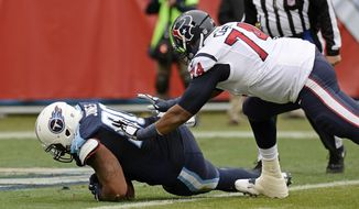 Tennessee Titans defensive lineman DaQuan Jones, left, recovers a Houston Texans fumble in the end zone for a touchdown ahead of Houston Texans tackle Chris Clark (74) in the first half of an NFL football game Sunday, Jan. 1, 2017, in Nashville, Tenn. (AP Photo/Mark Zaleski)