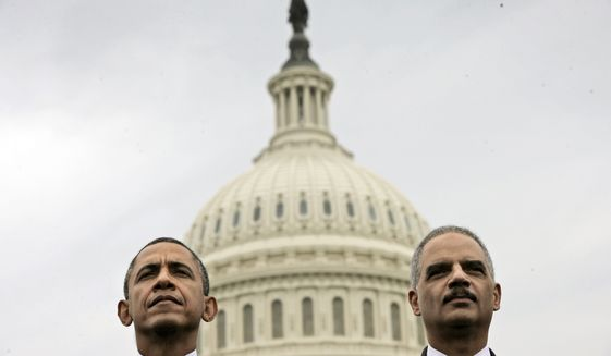 In this May 15, 2013, file photo, President Barack Obama sits with Attorney General Eric Holder during the 32nd annual the National Peace Officers Memorial Service on Capitol Hill in Washington. Obama has announced plans to improve Democrats down-ballot fortunes once he leaves office. He is launching an initiative with former Attorney General Eric Holder aimed at making Democratic gains when states redraw legislative district lines following the 2020 census. (AP Photo/Pablo Martinez Monsivais)