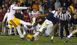 Southern California place kicker Matt Boermeester kicks the game winning field goal against Penn State during the second half of the Rose Bowl NCAA college football game Monday, Jan. 2, 2017, in Pasadena, Calif. (AP Photo/Mark J. Terrill)