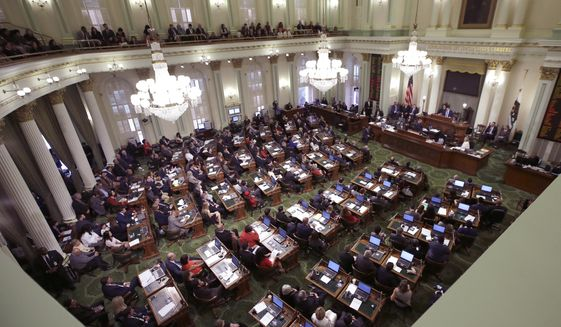 Members of the state Assembly listen to an address by Assembly Speaker Anthony Rendon, D-Paramount, at the in Sacramento, Calif. (AP Photo/Rich Pedroncelli, File)