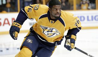 FILE - In this Oct. 1, 2016, file photo, Nashville Predators defenseman P.K. Subban warms up before an NHL hockey preseason game against the Tampa Bay Lightning, in Nashville, Tenn. Predators general manager David Poile updates the health of All-Star defenseman Subban on Monday, Jan. 2, 2017, a day after Nashville placed him on injured reserve with an upper-body injury. (AP Photo/Mark Humphrey, File)