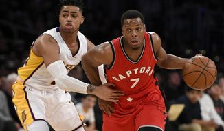 Toronto Raptors guard Kyle Lowry, right, drives the ball past Los Angeles Lakers guard D'Angelo Russell during the first half of an NBA basketball game in Los Angeles, Sunday, Jan. 1, 2017. (AP Photo/Kelvin Kuo)