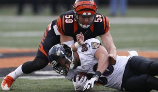Baltimore Ravens tight end Dennis Pitta (88) is tackled by Cincinnati Bengals inside linebacker Nick Vigil (59) iduringthe second half of an NFL football game, Sunday, Jan. 1, 2017, in Cincinnati. (AP Photo/Gary Landers)