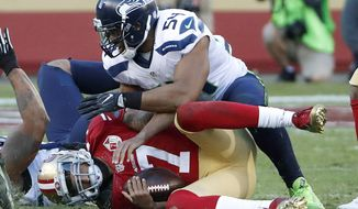 San Francisco 49ers quarterback Colin Kaepernick (7) is sacked by Seattle Seahawks middle linebacker Bobby Wagner (54) during the second half of an NFL football game in Santa Clara, Calif., Sunday, Jan. 1, 2017. (AP Photo/Tony Avelar)