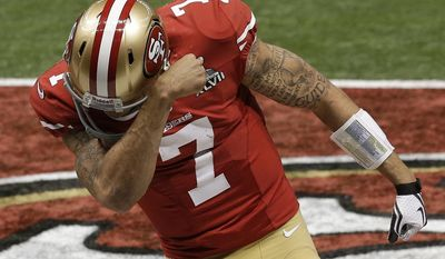 FILE - In this Sunday, Feb. 3, 2013, file photo, San Francisco 49ers quarterback Colin Kaepernick celebrates after running for a 15-yard touchdown against the Baltimore Ravens during the second half of the NFL Super Bowl XLVII football game in New Orleans. In 2012, 49ers quarterback Alex Smith went down in midseason with a concussion to be replaced by a not-yet-famous second-year quarterback, Kaepernick. He led the Niners to a 5-2 record down the stretch and into the playoffs on a roll. He ran for 181 yards in his playoff debut and took San Francisco all the way to the Super Bowl, where he joined Joe Montana as the only quarterbacks to pass for 300 yards and rush for 50 in the title game. (AP Photo/Elaine Thompson, File)