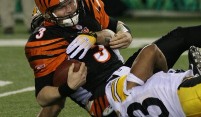 FILE - In this Sunday, Jan. 8, 2006, file photo, Cincinnati Bengals quarterback Jon Kitna (3) is sacked by Pittsburgh Steelers defenders Larry Foote, rear, and Clark Haggans (53) in the second half of their NFL playoff football game, in Cincinnati. Though Kitna doesn't get credit for a start in the playoffs, he played virtually the entire game for Cincinnati. Steelers nose tackle Kimo von Oelhoffen dove at Carson Palmer's knee on his first pass of the playoffs and knocked him from the game. Kitna took over and threw for 197 yards and two interceptions and the Bengals lost 31-17. (AP Photo/Tom Uhlman, File)