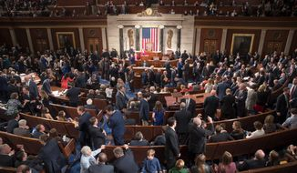 Members of the House of Representatives, some joined by family, gathered in the chamber on Tuesday for the swearing-in ceremony. All House members took the oath of office. (Associated Press)