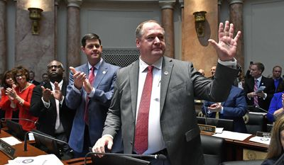 Kentucky House Majority Leader Jeff Hoover, R- Jamestown acknowledges the cheers of the Kentucky House of Representatives after he was named as Speaker of the House, Tuesday, Jan. 3, 2017, in Frankfort, Ky. (AP Photo/Timothy D. Easley)