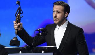 """Ryan Gosling accepts the Vanguard award for """"La La Land"""" at the 28th annual Palm Springs International Film Festival Awards Gala on Monday, Jan. 2, 2017, in Palm Springs, Calif. (Photo by Chris Pizzello/Invision/AP)"""