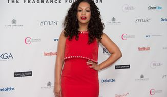 Rebecca Ferguson poses for photographers upon arrival for the Fragrance Foundation Awards at a central London venue, Thursday, May 14, 2015. (Photo by Jonathan Short/Invision/AP)