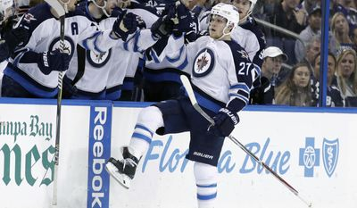 Winnipeg Jets right wing Nikolaj Ehlers (27), of Denmark, celebrates with the bench after scoring on a penalty shot against the Tampa Bay Lightning during the second period of an NHL hockey game Tuesday, Jan. 3, 2017, in Tampa, Fla. (AP Photo/Chris O'Meara)