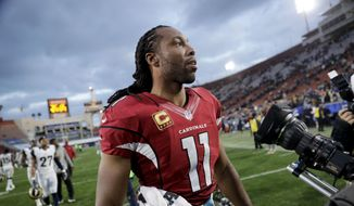 Arizona Cardinals wide receiver Larry Fitzgerald walks off the field after a win over the Los Angeles Rams in an NFL football game Sunday, Jan. 1, 2017, in Los Angeles. (AP Photo/Jae C. Hong) **FILE**