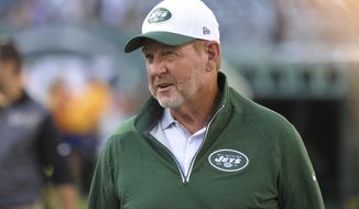 FILE - In this Aug. 21, 2015, file photo, New York Jets offensive coordinator Chan Gailey watches his team warm up for an NFL preseason football game against the Atlanta Falcons in in New York. Gailey has retired after two seasons on coach Todd Bowles' staff, according to a statement issued by the team Tuesday, Jan. 3, 2017. (AP Photo/Bill Kostroun, File)