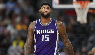 Sacramento Kings forward DeMarcus Cousins heads to the bench in the second half of an NBA basketball game against the Denver Nuggets late Tuesday, Jan. 3, 2017, in Denver. The Kings won 120-113. (AP Photo/David Zalubowski)