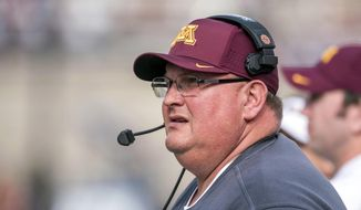 FILE - In this Oct. 29, 2016, file photo, Minnesota coach Tracy Claeys watches from the sideline during the second quarter of an NCAA college football game against Illinois at Memorial Stadium in Champaign, Ill. Two people with knowledge of the decision tell The Associated Press on Tuesday, Jan. 3, 2017,  that Minnesota has fired coach Tracy Claeys. The move comes two weeks after the football program became embroiled in a standoff with the administration over the suspension of 10 players in connection with allegations of sexual assault. The people spoke to the AP on condition of anonymity because the school has not announced the move. (AP Photo/Bradley Leeb, File)