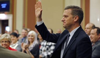 Rep. Kurt Daudt acknowledges the ovation after he was re-elected Speaker of the House as the 2017 Legislature convened Tuesday, Jan. 3, 2017, in St. Paul, Minn. (AP Photo/Jim Mone)