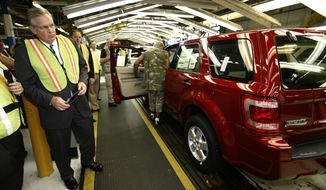 FILE - In this Sept. 9, 2009, file photo, Missouri Gov. Jay Nixon tours Ford's Kansas City Assembly Plant in Claycomo, Mo. During his administration, Nixon has highlighted business deals that are cumulatively projected to create about 48,000 jobs in exchange for as much as $2 billion of state incentives. As he prepares to leave office Jan. 9, fewer than half of those jobs have materialized so far and the state has paid out less than one-tenth of the potential incentives. More could come after Nixon's term. (AP Photo/Charlie Riedel, File)