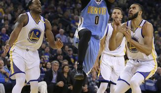 Denver Nuggets' Emmanuel Mudiay (0) shoots between Golden State Warriors' Andre Iguodala, left, Stephen Curry, and JaVale McGee, right, during the first half of an NBA basketball game Monday, Jan. 2, 2017, in Oakland, Calif. (AP Photo/Ben Margot)