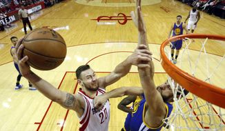 FILE - In this April 24, 2016, file photo, Houston Rockets' Donatas Motiejunas, left, heads to the basket as Golden State Warriors' Andrew Bogut defends during the first half in Game 4 of a first-round NBA basketball playoff series Houston. A person familiar with the negotiations says 7-footer Donatas Motiejunas has agreed to play the rest of this season alongside Anthony Davis with the New Orleans Pelicans for a pro-rated veteran minimum worth about $600,000. The person spoke to The Associated Press Tuesday, Jan. 3, 2017, on condition of anonymity because the contract has not yet been signed or announced, but was expected to be signed soon.  (AP Photo/David J. Phillip, File)