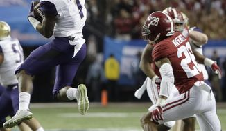 Washington wide receiver John Ross (1) makes the catch against Alabama defensive back Marlon Humphrey (26) during the first half of the Peach Bowl NCAA college football playoff game, Saturday, Dec. 31, 2016, in Atlanta. (AP Photo/David Goldman)