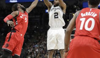 San Antonio Spurs forward Kawhi Leonard (2) shoots over Toronto Raptors forward DeMarre Carroll (5) during the second half of an NBA basketball game, Tuesday, Jan. 3, 2017, in San Antonio. San Antonio won 110-82.(AP Photo/Eric Gay)