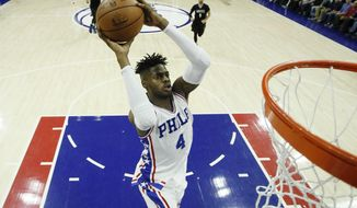 Philadelphia 76ers' Nerlens Noel goes up for a dunk during the first half of an NBA basketball game against the Minnesota Timberwolves, Tuesday, Jan. 3, 2017, in Philadelphia. (AP Photo/Matt Slocum)