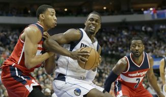 Dallas Mavericks forward Harrison Barnes (40) drives against Washington Wizards forward Otto Porter Jr., left, as guard John Wall (2) looks on during the second half of an NBA basketball game in Dallas, Tuesday, Jan. 3, 2017. The Mavericks won 113-105. (AP Photo/LM Otero)