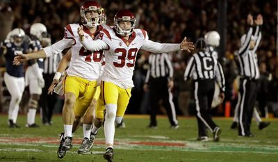 Southern California kicker Matt Boermeester (39) celebrates after the game winning field goal in the Rose Bowl on Monday. Ratings for the Rose Bowl jumped 20 percent from last year, but still down from when the game got consistent double-digit ratings. (Associated Press)