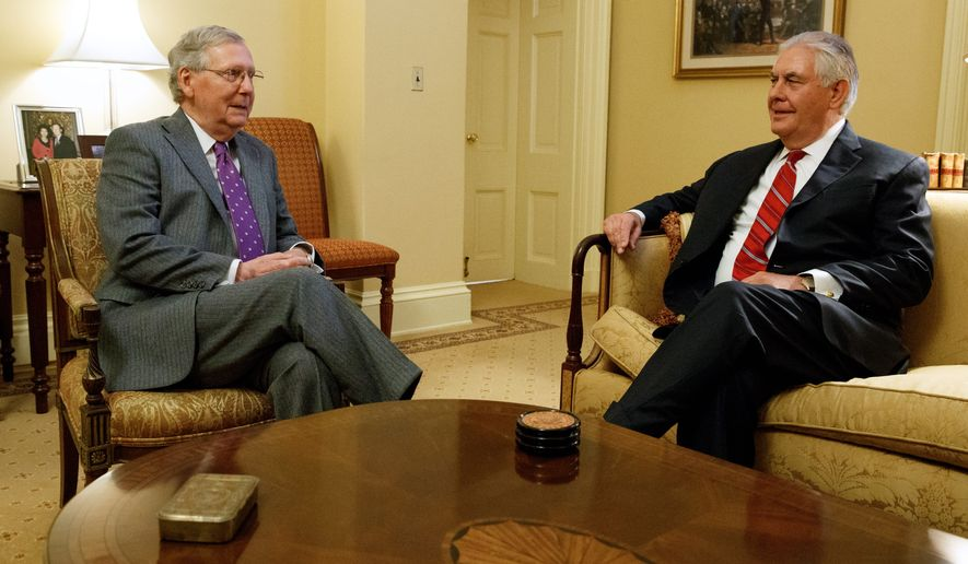 Senate Majority Leader Mitch McConnell (left) said that Republicans quickly confirmed President Obama's Cabinet picks in 2009, and pleaded for the same treatment for President-elect Donald Trump's picks, such as Secretary of State-designate Rex Tillerson. (Associated Press)