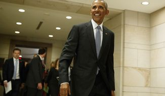President Barack Obama leaves a meeting on Capitol Hill in Washington, Wednesday, Jan. 4, 2017, about his signature healthcare law with members of Congress. (AP Photo/Evan Vucci)