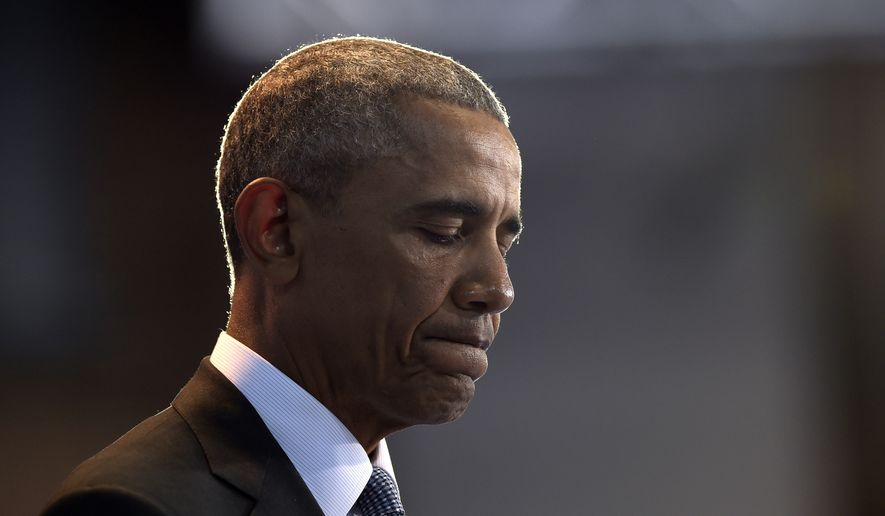 President Barack Obama pauses as he speaks during an Armed Forces Full Honor Farewell Review for him, Wednesday, Jan. 4, 2017, at Conmy Hall, Joint Base Myer-Henderson Hall, Va. (AP Photo/Susan Walsh)