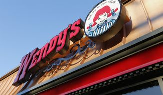 This Friday, March 21, 2014, file photo, shows a Wendy's restaurant in Providence, R.I. (AP Photo/Michael Dwyer, File)