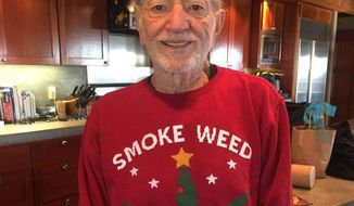Willie Nelson posted this photo of his marijuana-themed sweater on his Twitter feed.