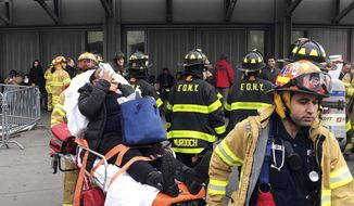 An injured passenger is taken from Atlantic Terminal in the Brooklyn borough of New York after a Long Island Rail Road train hit a bumping block, Wednesday, Jan. 4, 2017. (AP Photo/Mark Lennihan)