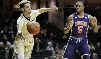 Vanderbilt guard Matthew Fisher-Davis, left, reaches for a loose ball by Auburn guard Mustapha Heron (5) in the first half of an NCAA college basketball game Wednesday, Jan. 4, 2017, in Nashville, Tenn. (AP Photo/Mark Humphrey)
