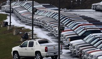 FILE - In this Wednesday, Jan. 9, 2013, file photo, Chevy trucks line the lot of a dealer in Murrysville, Pa. Demand may be slowing, but U.S. consumers still bought a whole lot of cars and trucks in 2016. U.S. sales of new vehicles could hit a new high in 2016. (AP Photo/Gene J. Puskar, File)