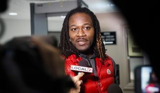 "Bengals cornerback Adam ""Pacman"" Jones speaks to reporters as he is released from the Hamilton County Justice Center after be charged with felony harassment with a bodily substance, Wednesday, Jan. 4, 2017, in Cincinnati. He is also charged with assault, disorderly conduct and obstructing police. An attorney representing Jones has told a Hamilton County judge that he ""vehemently denies"" the charges that led to his arrest. The judge set bonds totaling $37,500. (AP Photo/John Minchillo)"