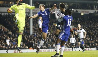 Tottenham's Dele Alli, second right, scores a goal during the English Premier League soccer match between Tottenham Hotspur and Chelsea at White Hart Lane stadium in London, Wednesday, Jan. 4, 2017. (AP Photo/Alastair Grant)