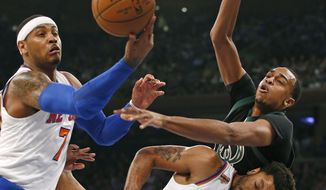 Milwaukee Bucks' center John Henson (31) loses the ball to New York Knicks' forward Carmelo Anthony (7) as New York Knicks' guard Derrick Rose (25) gets caught in the fray in the first half of an NBA basketball game at Madison Square Garden in New York, Wednesday, Jan. 4, 2017. (AP Photo/Kathy Willens)