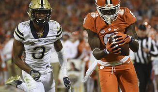 FILE- In this Nov. 12, 2016, file photo, Clemson wide receiver Deon Cain (8) makes a catch as Pittsburgh defensive back Damar Hamlin (3) defends during the second half of an NCAA college football game in Clemson, S.C. Two of Clemson's most critical pieces last year were not on the field when the Tigers faced Alabama. This time, Mike Williams is back from injury and Deon Cain has kept himself straight after getting sent home during last year's postseason. Both are ready to make an impact against the Crimson Tide on Monday night. (AP Photo/Rainier Ehrhardt, File)