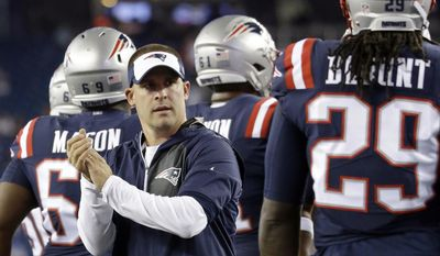 FILE - In this Sept. 22, 2016, file photo, New England Patriots offensive coordinator Josh McDaniels encourages players during warm ups before an NFL football game against the Houston Texans in Foxborough, Mass. With six vacancies around the NFL, head coach candidates are being carted around the country for interviews. The hot prospects, unsurprisingly, are in New England with assistants Josh McDaniels and Matt Patricia topping the list. (AP Photo/Elise Amendola, File)