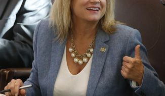 Oklahoma state Rep. Leslie Osborn, R-Mustang, gestures as she talks with a colleague on the House floor in Oklahoma City, Wednesday, Jan. 4, 2017. Oklahoma's Department of Education says it needs $221 million more in funding for the next school year just to keep pace with student growth. (AP Photo/Sue Ogrocki)